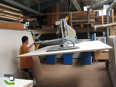 Manual handling assistance for large wooden panels, ergonomics