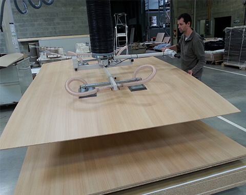 Handling of wood panels